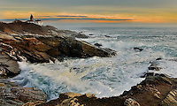 Waves glow from the sunset as they crash on the rocks at Beavertail.