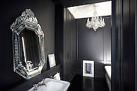In this bathroom a Venetian mirror and 18th century-style chandelier create an atmosphere of theatrical opulence while the maple parquet has been stained the colour of Chinese ink and given a coat of satin varnish