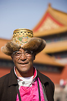 Man from Chinese minority group visits the Forbidden City, Beijing, China