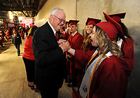 NWA Democrat-Gazette/ANDY SHUPE<br /> Linzie Palmer (right), a graduating senior at Springdale High School, smiles Saturday, May 20, 2017, as she is congratulated by Jim Rollins, superintendent of Springdale Public Schools, before the start of the school's commencement exercises for 615 students in Bud Walton Arena on the University of Arkansas campus in Fayetteville. Visit nwadg.com/photos to see more photographs from the ceremony.
