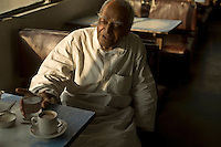An elderly man in the Indian Coffee House, Baba Kharak Singh Marg, New Delhi.