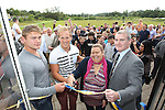 SWALEC volunteer Kirsty Parsons and Newport High School Old Boys Chairman Jim Brunnock along with Newport Gwent Dragons players Lewis Evans and Ashley Smith officially open the clubhouse after SWALEC staff renovated the building..15.07.12.©Steve Pope