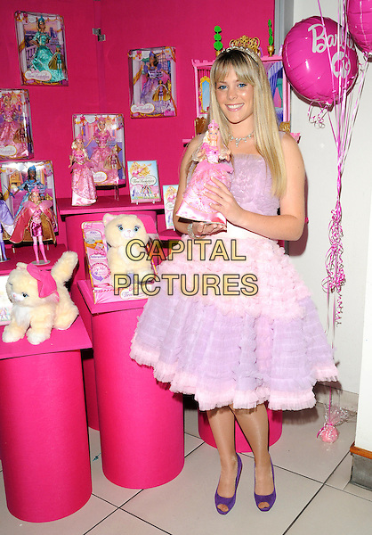 """BARBIE.At the """"Barbie and the Three Musketeers"""" VIP Premiere, Odeon Leicester square, London, England, UK,.September 27th 2009..3 full length pink dress tulle ruffle skirt model purple peep toe shoes holding doll toy waist belt ruffles lilac .CAP/CAN.©Can Nguyen/Capital Pictures"""