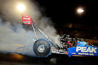 Sept. 28, 2012; Madison, IL, USA: NHRA top fuel dragster driver T.J. Zizzo during qualifying for the Midwest Nationals at Gateway Motorsports Park. Mandatory Credit: Mark J. Rebilas-