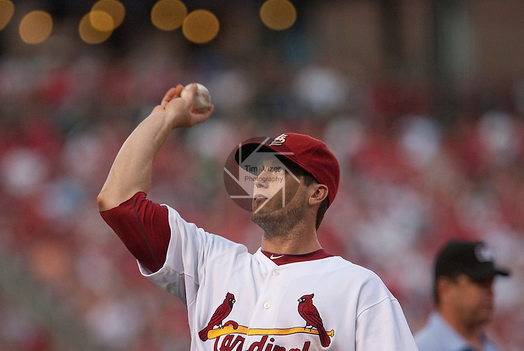 June 18, 2010       St. Louis Cardinals third baseman David Freese (23) looks into the stands to throw a ball to a fan.  The St. Louis Cardinals defeated the Oakland Athletics 6-4 in the first game of a three-game homestand at Busch Stadium in downtown St. Louis, MO on Friday June 18, 2010.
