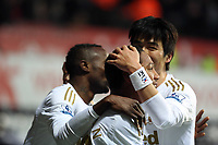 Saturday 19 January 2013<br /> Pictured: Jonathan de Guzman (C) of Swansea celebrating his second goal with team mates Roland Lamah (L) and Ki Sung Yueng (R).<br /> Re: Barclay's Premier League, Swansea City FC v Stoke City at the Liberty Stadium, south Wales.