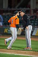 Bowie Baysox manager Gary Kendall (35) shakes hands with Tucker Nathans (6) after a game against the Erie SeaWolves on May 12, 2016 at Jerry Uht Park in Erie, Pennsylvania.  Bowie defeated Erie 6-5.  (Mike Janes/Four Seam Images)
