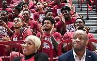 NWA Democrat-Gazette/CHARLIE KAIJO Arkansas Razorbacks players watch the NCAA selection show with head coach Mike Anderson (right) and his wife Marcheita Anderson (left), Sunday, March 11, 2018 at Bud Walton Arena in Fayetteville. The Razorbacks will play Butler in Detroit on Friday
