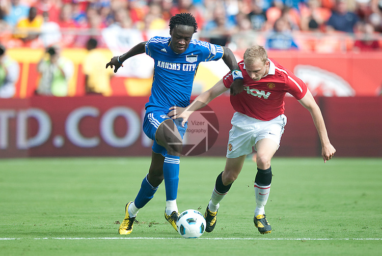 """July 25, 2010         Kansas City Wizards forward Kei Kamara (23, left) battles Ritchie De Laet (30, right) for the ball in the first half.  The Kansas City Wizards of Major League Soccer hosted England's Manchester United of the English Premier League in an international friendly game on Sunday July 25, 2010 at Arrowhead Stadium in Kansas City, Missouri.  The game is the third of four stops for Manchester United on their """"Tour 2010"""", which is four games in North America."""