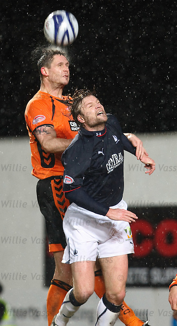 Lee Wilkie heads clear of Steven Pressley