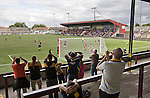 Supporters of Alloa Athletc football club (in yellow) cheering on their team at Ochilview stadium, Larbert, during their team's Irn Bru Scottish League second division match against Stenhousemuir. Alloa won the match by one goal to nil against their local rivals in a match watched by 619 spectators.