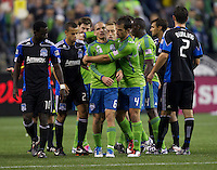 Seattle Sounders FC defender Patrick Ianni calms midfielder Osvaldo Alonso after scuffle with San Jose Earthquakes players during play between the Seattle at CenturyLink Field in Seattle Saturday October 15, 2011. The Sounders FC won the game 2-1.