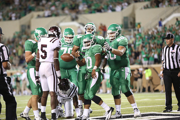 Denton, TX - SEPTEMBER 8: Jeremy Brown #20 of the North Texas Mean Green makes a touchdown against Tryerrell Jones #11 of the Texas Southern Tigers at Apogee Stadium in Denton on September 8, 2012 in Denton, Texas. NT won 34-7. Photo by: Rick Yeatts