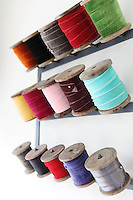 Reels of colourful velvet ribbon make a colourful display on one of the walls of Kally Ellis's kitchen