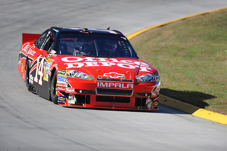 TONY STEWART, during practice laps in preparation for the Tums Fast Relief 500 in Martinsville, VA..