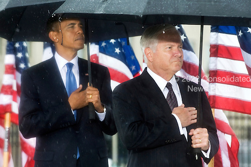 Washington, DC - September 11, 2009 -- United States President Barack Obama and Secretary of Defense, Robert M. Gates participate in the commemoration ceremony marking the eighth anniversary of the terrorist attacks that killed 59 passengers onboard hijacked American Airlines flight 77 crashing it into the Pentagon killing 125 inside. .Mandatory Credit: Chad J. McNeeley - DoD via CNP