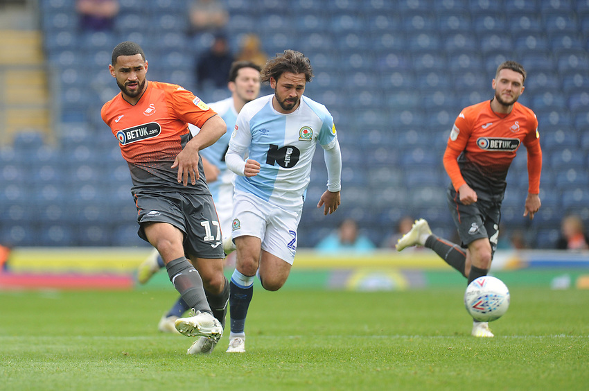 Swansea City's Cameron Carter-Vickers under pressure from Blackburn Rovers' Bradley Dack<br /> <br /> Photographer Kevin Barnes/CameraSport<br /> <br /> The EFL Sky Bet Championship - Blackburn Rovers v Swansea City - Sunday 5th May 2019 - Ewood Park - Blackburn<br /> <br /> World Copyright © 2019 CameraSport. All rights reserved. 43 Linden Ave. Countesthorpe. Leicester. England. LE8 5PG - Tel: +44 (0) 116 277 4147 - admin@camerasport.com - www.camerasport.com