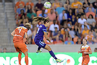 Alex Morgan (13) of the Orlando Pride heads the ball over Rebecca Moros (4) of the Houston Dash on Friday, May 20, 2016 at BBVA Compass Stadium in Houston Texas. The Orlando Pride defeated the Houston Dash 1-0.