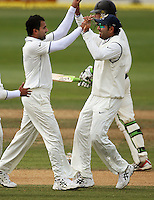 India's Yuvraj Singh congratulates Zaheer Khan on dismissing Tim McIntosh for 4 during day four of the 3rd test between the New Zealand Black Caps and India at Allied Prime Basin Reserve, Wellington, New Zealand on Monday, 6 April 2009. Photo: Dave Lintott / lintottphoto.co.nz.