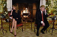 President Donald Trump and first lady Melania Trump participate in NORAD Santa Tracker phone c
