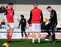 Fleetwood Town's first team coach Andy Mangan, right, with Fleetwood Town's Ched Evans, left, and Fleetwood Town's Paddy Madden during the pre-match warm-up<br /> <br /> Photographer Chris Vaughan/CameraSport<br /> <br /> The EFL Sky Bet League One - Saturday 23rd February 2019 - Burton Albion v Fleetwood Town - Pirelli Stadium - Burton upon Trent<br /> <br /> World Copyright © 2019 CameraSport. All rights reserved. 43 Linden Ave. Countesthorpe. Leicester. England. LE8 5PG - Tel: +44 (0) 116 277 4147 - admin@camerasport.com - www.camerasport.com