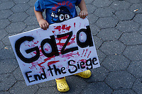 New York, USA. 24 July 2014. A boy holds a banner during a protest by Palestine supporters in New York, demanding the end of the war by Israel and Hamas in Gaza. Photo by Eduardo Munoz Alvarez/VIEWpress