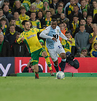 Blackburn Rovers' Amari'i Bell (right) is tackled by Norwich City's Mario Vrancic (left) <br /> <br /> Photographer David Horton/CameraSport<br /> <br /> The EFL Sky Bet Championship - Norwich City v Blackburn Rovers - Saturday 27th April 2019 - Carrow Road - Norwich<br /> <br /> World Copyright © 2019 CameraSport. All rights reserved. 43 Linden Ave. Countesthorpe. Leicester. England. LE8 5PG - Tel: +44 (0) 116 277 4147 - admin@camerasport.com - www.camerasport.com