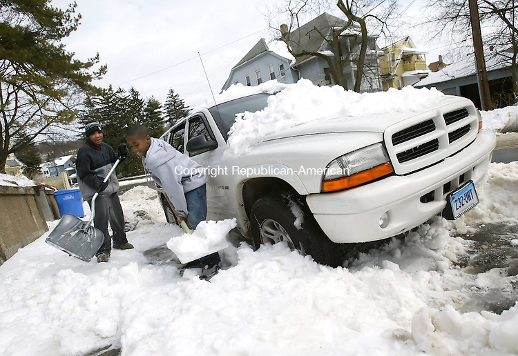 WATERBURY, CT, 03/17/07- 031707BZ01- Taven Williams, 12, and his friend Shonsa Young, 11, shovel snow from the sidewalk and from around Willliam's mothers SUV on Pine Street in Waterbury Saturday afternoon.   <br /> Jamison C. Bazinet Republican-American