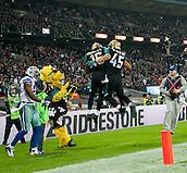 09.11.2014.  London, England.  NFL International Series. Jacksonville Jaguars versus Dallas Cowboys. Jaguars' Will Ta'ofo'ou (#45) celebrates Jacksonville Jaguars' Running Back Denard Robinson (#16) touchdown.