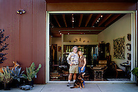 Los Angeles, California, November 14, 2009 - Portrait of Ernie and Diane Wolfe with their dog Malaika in the backyard of their home, which is based on a Quonset hut. The Wolfe's own the Ernie Wolfe Gallery and are the most reknowned African at dealers in the country. ..CREDIT: Daryl Peveto/LUCEO for The Wall Street Journal.Homefront - Ernie Wolfe #1348.