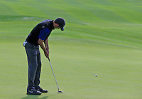 Ross Fisher (ENG) takes his putt on the 5th green during Sunday's Final Round of the 2014 BMW Masters held at Lake Malaren, Shanghai, China. 2nd November 2014.<br /> Picture: Eoin Clarke www.golffile.ie