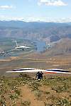 Hang Glider pilots wait their turn to launch off Chelan Butte in eastern Washington State. The Columbia River is in the background.