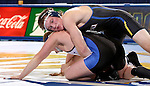 BROOKINGS, SD - JANUARY 11:  Ben Schwery from South Dakota State University controls Kyle Gerlach from Dakota Wesleyan in their 165 pound match Sunday afternoon at Frost Arena in Brookings. (Photo by Dave Eggen/Inertia)