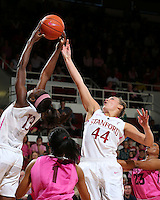 STANFORD, CA - February 10, 2013: Stanford Cardinal's Chiney Ogwumike (13) and Joslyn Tinkle (44) on a rebound during Stanford's game against Arizona State at Maples Pavilion in Stanford, California.  The Cardinal defeated the Sun Devils 69-45.