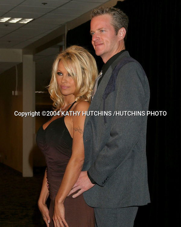 "©2004 KATHY HUTCHINS /HUTCHINS PHOTO.""ADOPT-A-MINEFIELD"" BENEFIT.CENTURY CITY, CA.OCTOBER 15, 2004..PAM ANDERSON.DAN MATHEWS, VP PETA."