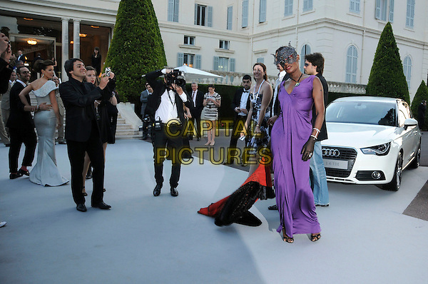 GRACE JONES.arrivals at amfAR's Cinema Against AIDS 2010 benefit gala at the Hotel du Cap, Antibes, Cannes, France during the Cannes Film Festival.20th May 2010.amfAR full length black face covered lace mask purple dress ruched gloves sleeveless long maxi .CAP/CAS.©Bob Cass/Capital Pictures.