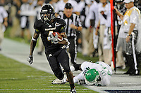 1 September 2011:  FIU's T.Y. Hilton (4) breaks for the end zone after evading North Texas' K.C. Obi (46) in the first half as the FIU Golden Panthers defeated the University of North Texas, 41-16, at University Park Stadium in Miami, Florida.