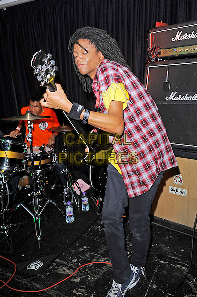 Solomon Radke &amp; Dee Radke of Radkey <br /> performing in concert, The Blackeart, Camden, London, England. <br /> 17th October 2013<br /> on stage in concert live gig performance performing music full length red check shirt yellow top guitar drums<br /> CAP/MAR<br /> &copy; Martin Harris/Capital Pictures
