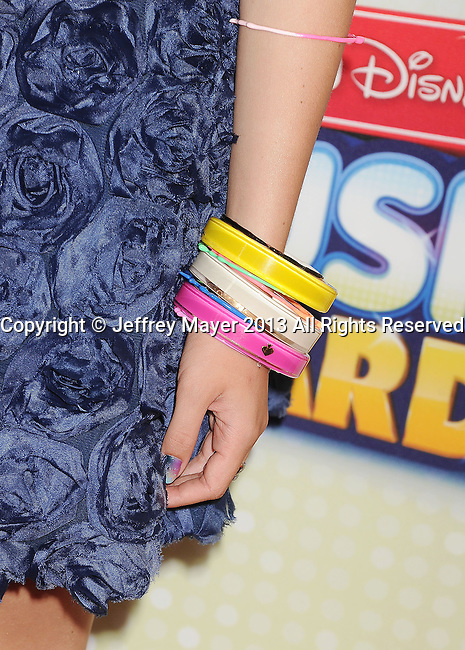 LOS ANGELES, CA- APRIL 27: Actress Bella Thorne (bracelets detail) at the 2013 Radio Disney Music Awards at Nokia Theatre L.A. Live on April 27, 2013 in Los Angeles, California.