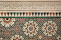 Carved stucco detail and coloured zellige tiles in geometric patterns in the Mausoleum of Moulay Ismail, or Moulay Ismail Ibn Sharif, reigned 1672ñ1727, second ruler of the Alaouite dynasty, built 1703 by Ahmed Eddahbi, Meknes, Meknes-Tafilalet, Morocco. Meknes is a fortified Imperial city redeveloped under Sultan Moulay Ismail, 1634-1727, as Morocco's political capital. Picture by Manuel Cohen