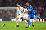 Adam Lallana of England battles Miso Brecko of Slovenia - England vs. Slovenia - UEFA Euro 2016 Qualifying - Wembley Stadium - London - 15/11/2014 Pic Philip Oldham/Sportimage