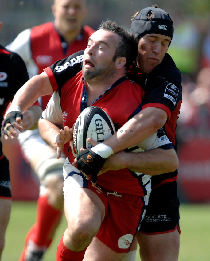 Photo: Richard Lane..Gloucester Rugby v Saracens. Guinness Premiership Play-Off. 05/05/2007. .Gloucester's Mefin Davies is tackled by Saracens' Ben Skirving.