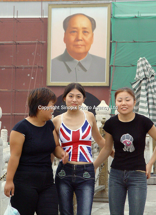 Young girls in front of the Tiananmen Square and the Chairman Mao's portrait in Beijing, China..28-AUG-02