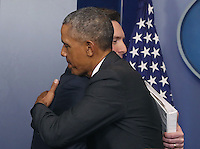United States President Barack Obama hugs White House Press Secretary Josh Earnest during his last briefing for the administration at the White House, on January 17, 2017 in Washington, DC. On Friday January 20th, President-elect Donald Trump will be sworn in as the nation's 45th president. Photo Credit: Mark Wilson/CNP/AdMedia