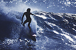 Silhouetted by the sunset a surfer catches a wave off Northshore, on the Island of Honolulu, Hawaii. (Jim Bryant Photo).....