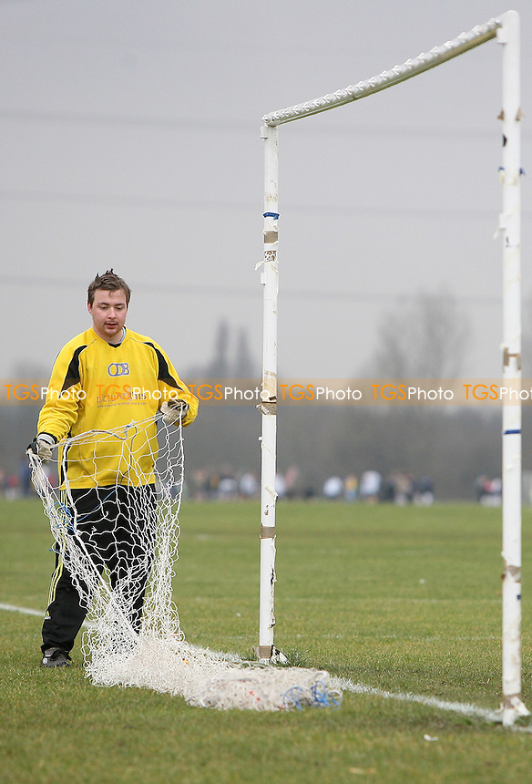 Baris Spor personnell put up the goal nets before kick-off - Baris Spor (white) vs Florist Arms - Hackney & Leyton League at South Marsh, Hackney - 07/02/10 - MANDATORY CREDIT: Gavin Ellis/TGSPHOTO - Self billing applies where appropriate - Tel: 0845 094 6026