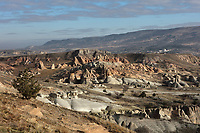 Landscape between Urgup in Nevsehir province and Ortahisar in Trabzon province, Cappadocia, Central Anatolia, Turkey. The rock formations here were made by erosion of the volcanic tuff created by ash from volcanic eruptions millions of years ago. Some of the formations have been carved out to form dwellings by early christians who came here to flee persecution by the Romans. This area forms part of the Goreme National Park and the Rock Sites of Cappadocia UNESCO World Heritage Site. Picture by Manuel Cohen