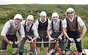 Grand Depart - Tour de France 2014<br /> Yorkshire England.<br /> Second stage passes through &quot;Blubberhouses Moor&quot;<br /> on the road from Harrogate<br /> Cycling fans dressed as Monty Python  &quot;Gumby&quot; Gumbys<br /> characters.<br /> from the famous sketch<br /> Merrell Brothers - Andy, Martin, Gary, Simon - with their friend also Martin.<br /> <br /> <br /> <br /> Pic by Gavin Rodgers/Pixel 8000 Ltd