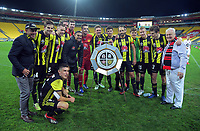 The Phoenix pose with the Blacktown Porirua Sister Citiy Shield after the A-League football match between Wellington Phoenix and West Sydney Wanderers at Westpac Stadium in Wellington, New Zealand on Sunday, 17 March 2019. Photo: Dave Lintott / lintottphoto.co.nz