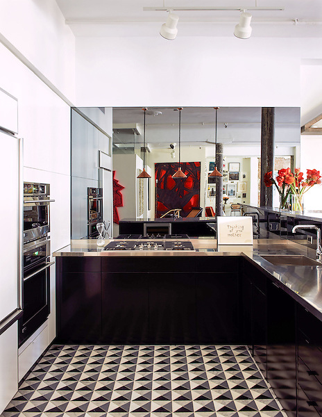 This custom kitchen floor features Christopher 2, a handmade mosaic shown in honed Nero Marquina, Thassos, Carrara, and Bardiglio, apart of the Illusions&trade; Collection by Sara Baldwin Designs for New Ravenna.<br />